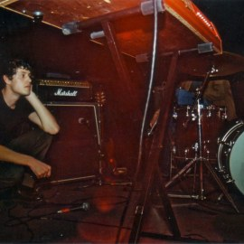Josh taking an on-stage break at The Brickyard in Vancouver, 2002.