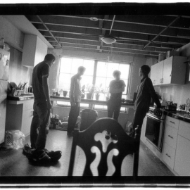 Candid photo in the kitchen old Bottleneck Distribution centre in Oakland CA, 1999.
